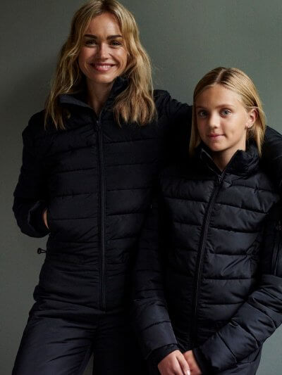 Snowsuit for women. The Dalset ONE black overall for women. Warm and stylish one-piece with a moder fit. Available in 9 sizes.